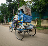 A man riding tricycle on street in Bodhgaya, India Stock Image