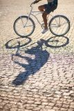 Man riding on vintage bicycle by road Royalty Free Stock Image