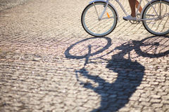 Man riding on vintage bicycle by road Stock Photos