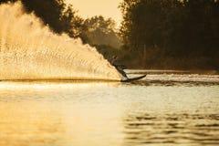 Man riding wakeboard on lake with splashes Stock Photo