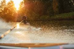 Man riding wakeboard on wave Royalty Free Stock Photo