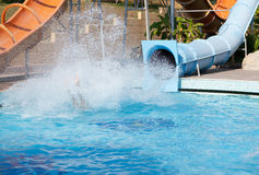 Man riding a water slide. Pool in the Turkish hotel Royalty Free Stock Images