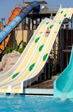 Man riding a water slide Stock Photo
