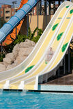 Man riding a water slide Royalty Free Stock Image
