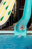 Man riding a water slide Stock Photography