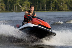Man riding wave runner in river Stock Photography