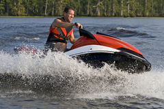 Man riding wave runner in river Royalty Free Stock Images