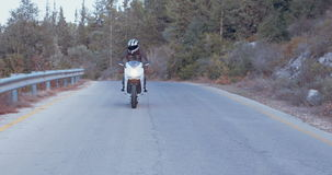 Man riding a white sport motorcycle stock footage
