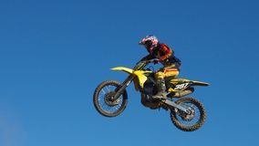 Man Riding Yellow Motocross Dirt Bike Royalty Free Stock Image