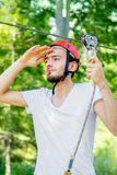 Man riding on a zip line stock photography