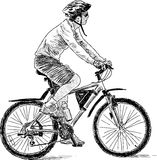 Man rids on a bike Stock Photography