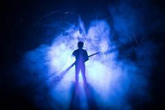 Man with riffle at spooky forest at night with light, or War Concept. Military silhouettes fighting scene on war fog sky backgroun. D, World War Soldier Stock Photos