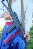 Man with rifle AK-47. Man in Ukrainian linen shirt and trousers with rifle AK-47 Stock Images