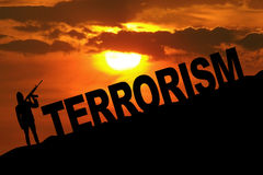 Man with rifle and terrorism text on the hill Royalty Free Stock Image