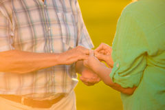 Man with ring on finger. Hands of elderly couple. Union of strong hearts. Today is our golden wedding Stock Images