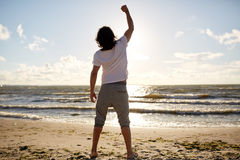 Man with rised fist on beach Royalty Free Stock Photos