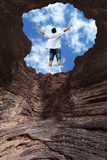 Man Rising Arms Concept of Hope. Man rising arms at the end of the tunnel concept of success stock image