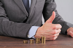 Man Rising Coins close up. Money, investment, business, financial growth, profit,  dividends concept Stock Photo