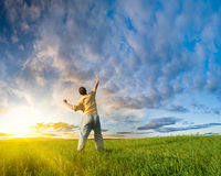 Man rising up hand. Man rising up right hand before sun royalty free stock images