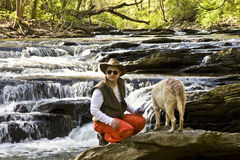 Man in River with Dog Royalty Free Stock Images