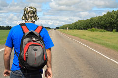 Man on road. Man going on road to solar summer day Royalty Free Stock Images