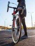 Man with road bike close-up stock photos