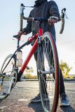 Man with road bike close-up stock photo