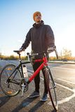 Man with road bike. Looks forward to the road stock photography