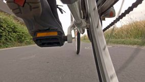 Man on road bike riding on a typical street in the countryside of Germany.  stock footage