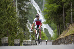 Man road cycling uphill. Endurance cycling race in the mountains Royalty Free Stock Images