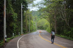 Man on the road. In Pang Sida National Park at Thailand Stock Photos