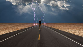 Man on road before storm Stock Photo