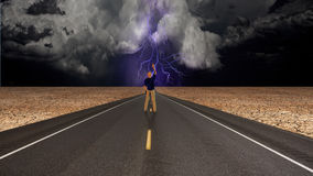 Man on road before storm Royalty Free Stock Image