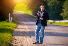 Man on a road, sunshine Royalty Free Stock Images