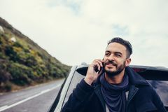 Man on road trip making a phone call Royalty Free Stock Image