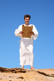Man in robe reading Royalty Free Stock Photos