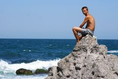 Man on the rock Royalty Free Stock Images