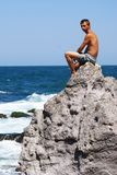 Man on the rock Stock Photography