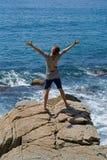 Man on rock 6 Stock Photos