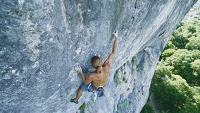 Man rock climber climbing on a limestone cliff