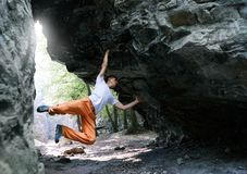 Man rock climber climbing on the overhanging cliff royalty free stock photos