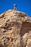 Man rock climbing, Joshua Tree National Park Stock Image