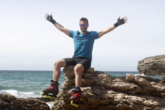 Man on a rock with his arms open. In Lisbon, Portugal Royalty Free Stock Images