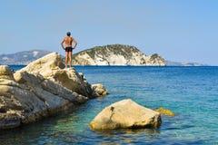 The man on the rock. The man on the rock in sea. Marathias beach, Zakynthos Island, Greece stock photos