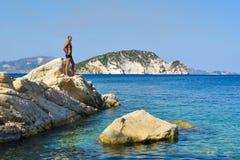 The man on the rock. The man on the rock in sea. Marathias beach, Zakynthos Island, Greece royalty free stock photos
