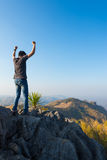 Man on rock at mountain Royalty Free Stock Image