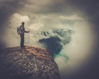 Man on rock's edge Stock Images