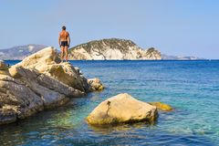 The man on the rock. The man on the rock in sea. Marathias beach, Zakynthos Island, Greece royalty free stock photography