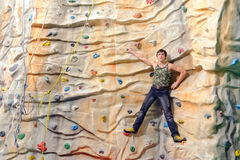 Man on rock wall in sport center Royalty Free Stock Photo