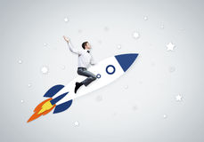 Man on rocket. Young businessman,an flying in sky on drawn rocket stock illustration